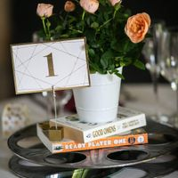 Sweetheart table centerpiece with our favorite books