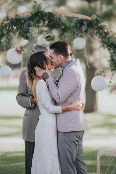 Ceremony kiss outdoor venue with arch