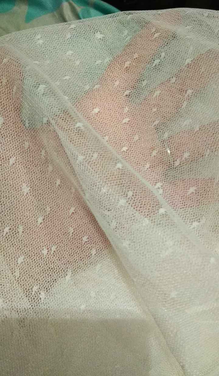 The tulle has little dot details in it