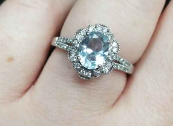 He picked it out on his own and I am so in love with it! Aquamarine center stone surrounded by diamo
