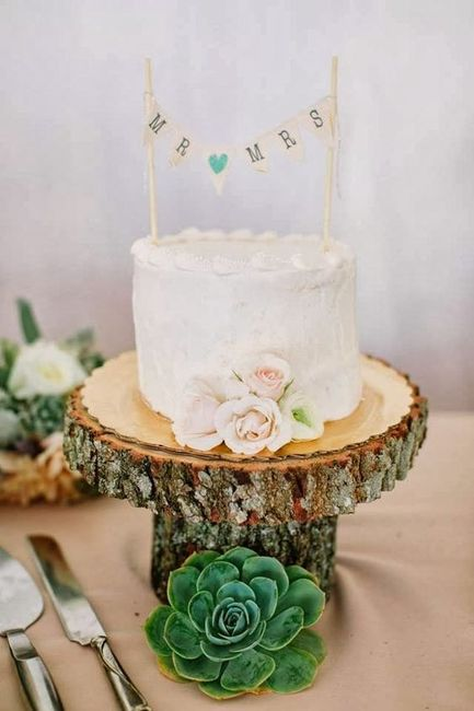 small wedding cake on stand with bunting