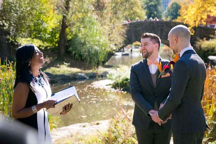 wedding ceremony couple laughing with officiant outdoors