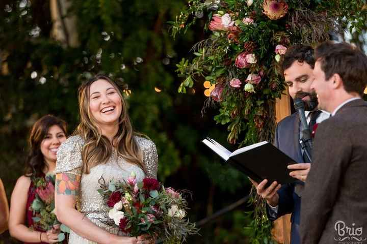 wedding ceremony couple laughing with officiant outdoors reading guest
