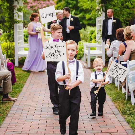 children in ceremony with signs