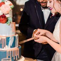 wedding reception cake cutting flower decor bride and groom