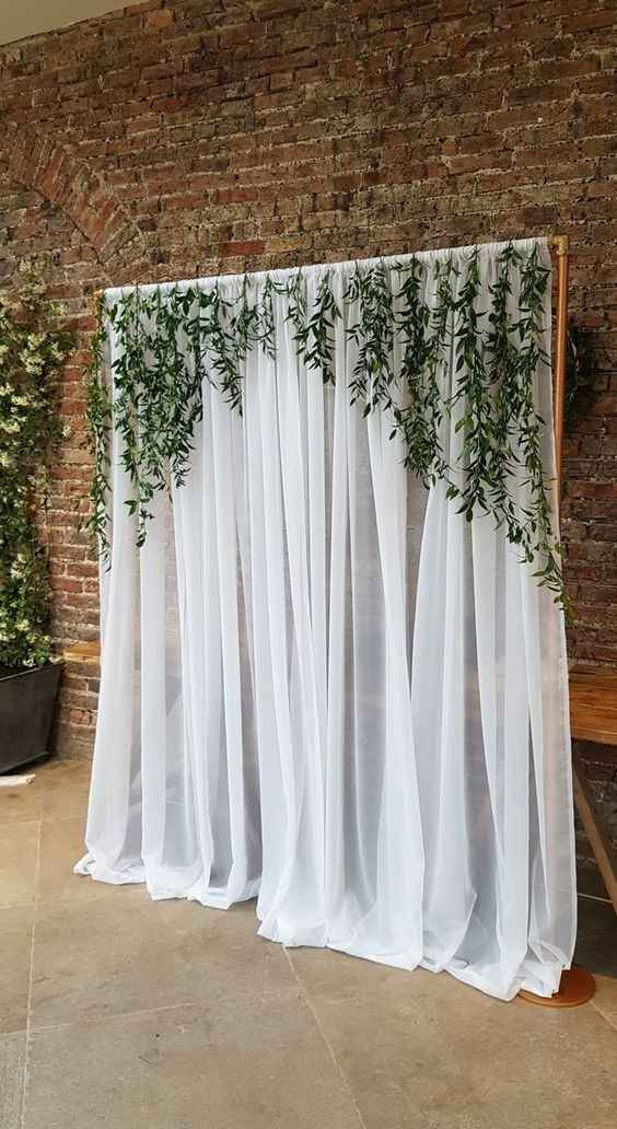 wedding backdrop with pipping, draping and greenery