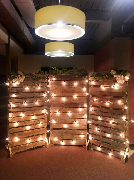 wedding backdrop with pallets and lights