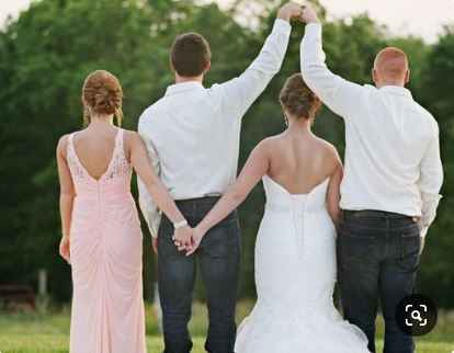 maid of honour, best man and couple shot, holding hands and fist bump