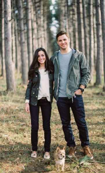 casual couple engagement shoot in woods, jeans, shirt and jacket