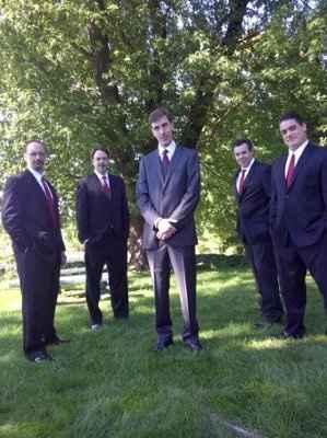 should the groomsmen wear suits or tuxedos?