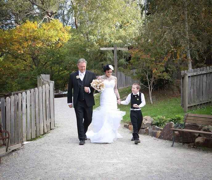 Bride walking with her father and her son