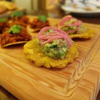 tostones with guacamole and a picked onion