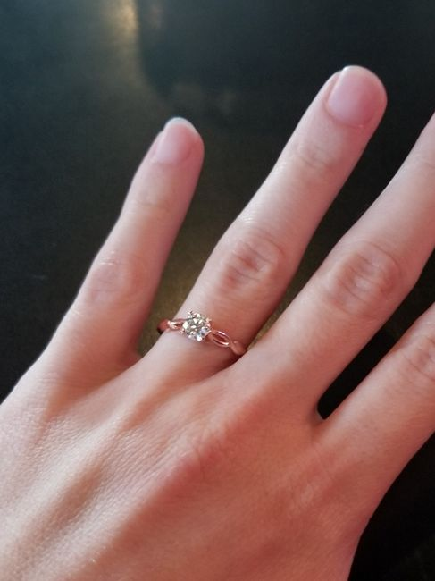 Who has a rose gold ring? 2