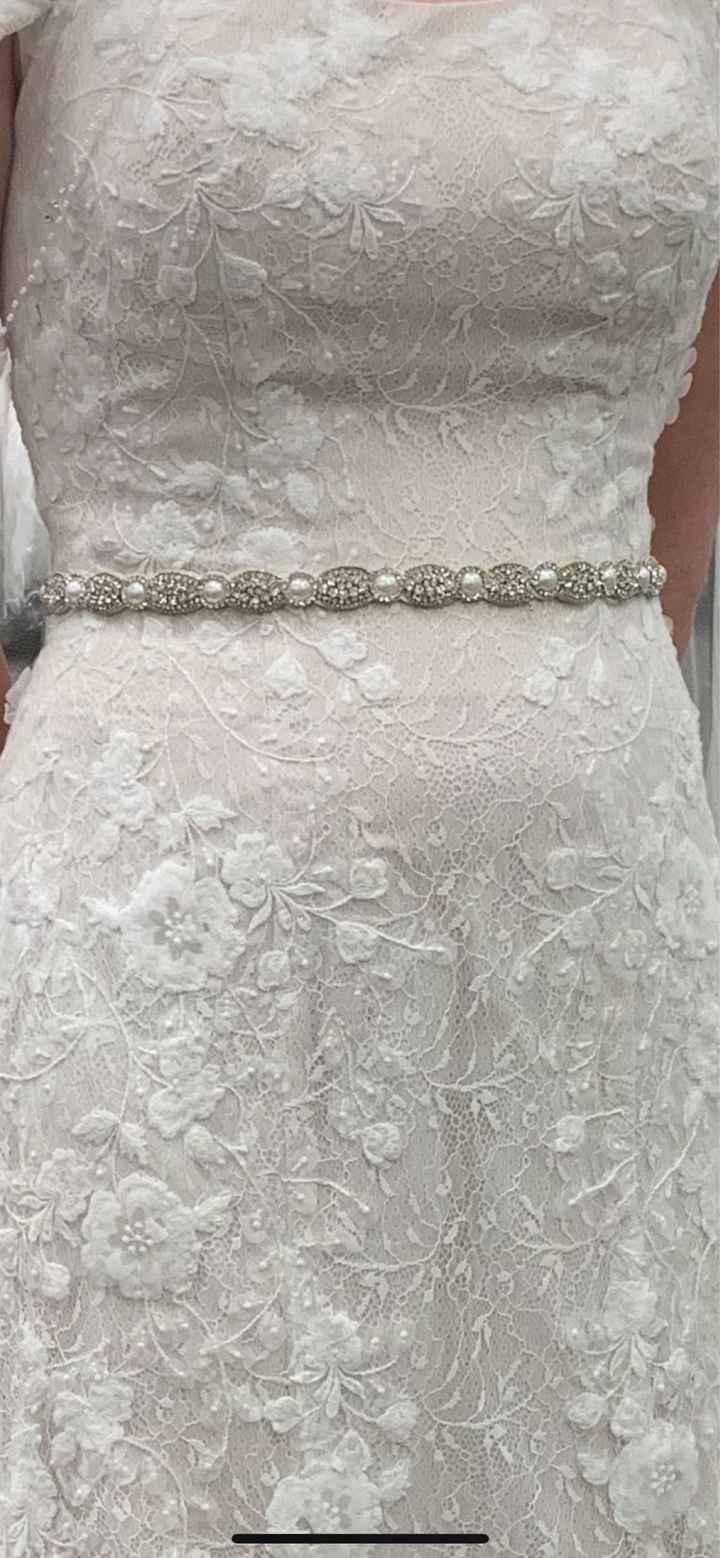 Show off your wedding belt. - 1