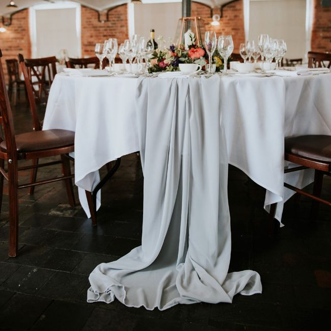 White Round Tables with a Black Chiffon Runner? - 1