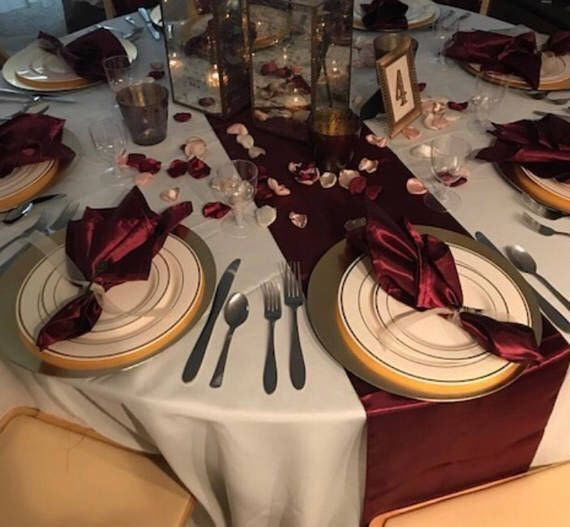 Centerpieces For A Navy Burgundy Blush And Gold Wedding