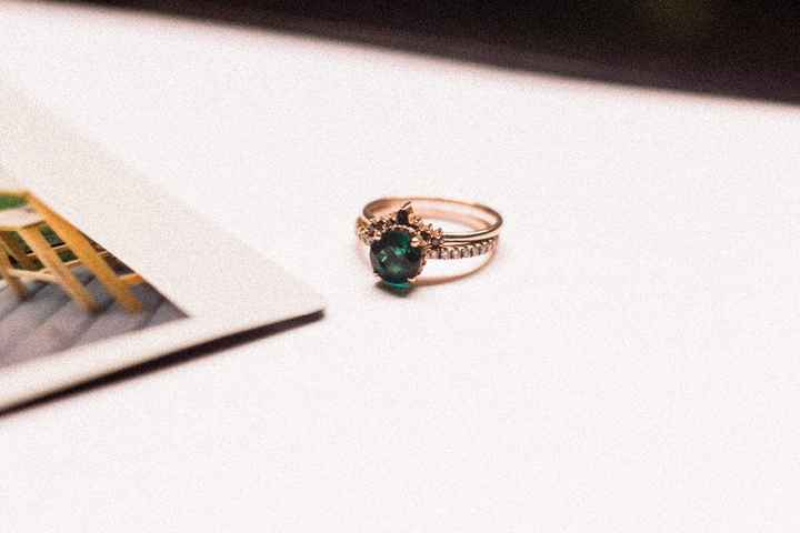 Black diamonds on the band and emerald with white diamonds on the ring