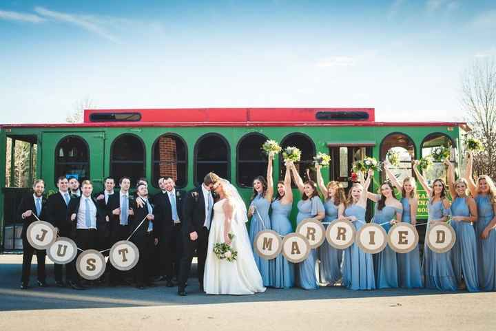Wedding Party with Just Married Banner in front of Trolley