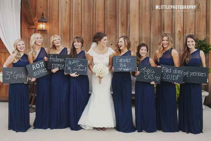 Bridesmaids with 'how we met' signs