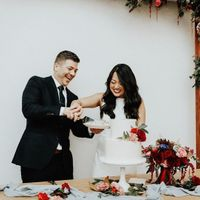Couple Cutting Wedding Cake - Red Flowers Decor