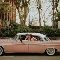 Blush Pink Luxury Vintage Getaway Car Transportation - Bride and Groom Kissing Out Windows