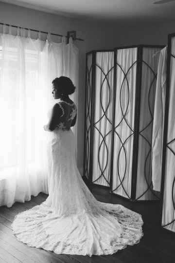 Bride Looking Out the Window in Her Wedding Dress