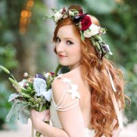 redheaded bride holding bouquet wearing a flower crown