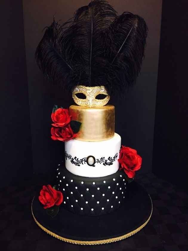 Masquerade cake in white, black, and gold tones