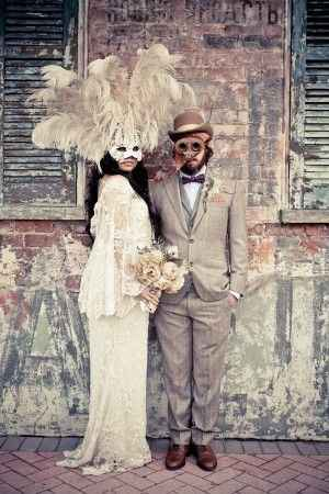 Masquerade wedding couple in front of old building