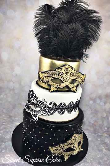 Black and gold wedding cake with masks