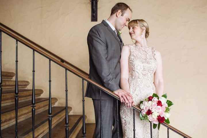Bride and groom standing on staircase on Valentine's Day wedding