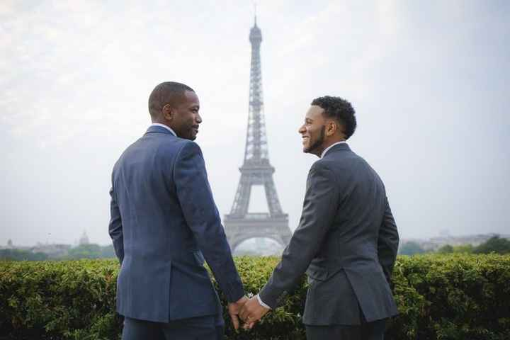 Parisian African-American Gay couple in front of the Eiffel Tower