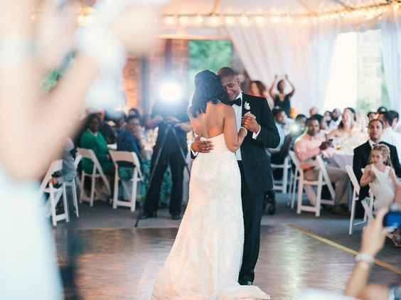 Videopgarher filming African american couple's first dance