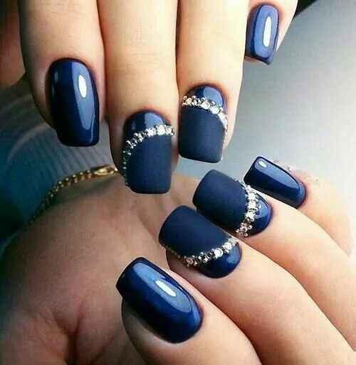Navy blue nails with shiny diamond detailing