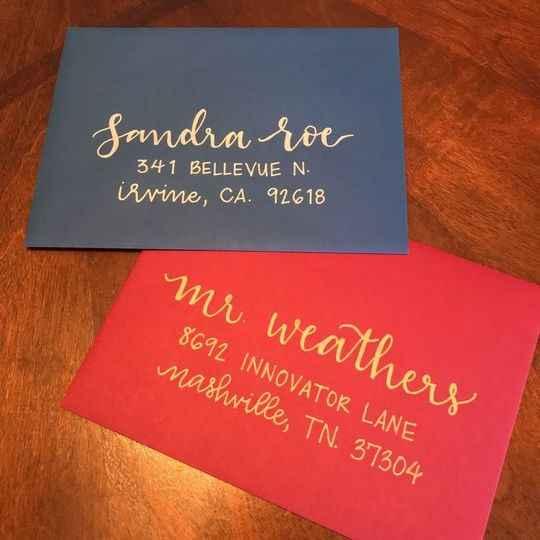Addressed red and blue wedding invitation envelopes