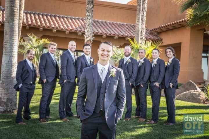 Groom and groomsmen in navy tuxes