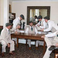 Groomsmen giving groom advice