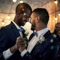 Gay couple dancing amid sparkles