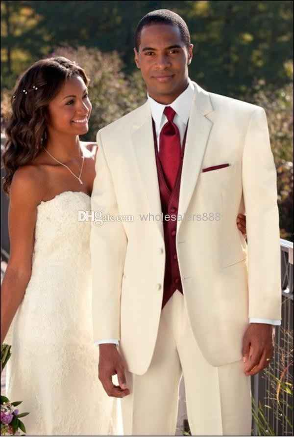 White suit, burgundy vest + tie