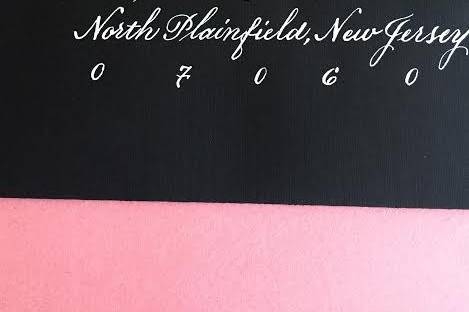 Black card, white calligraphy