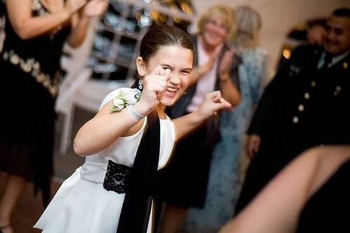 Junior bridesmaid dancing