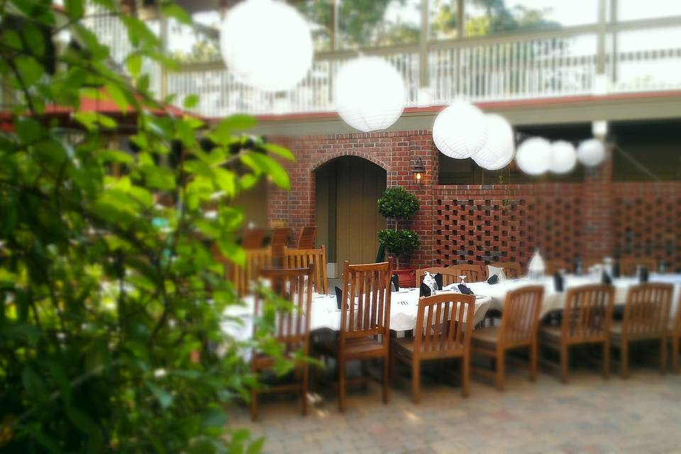Our 1600 sq/ft. outdoor courtyard is perfect for intimate receptions or rehearsal dinners. The space also includes our adjoining 800 sq ft. indoor clubroom. Both areas combined can accommodate 50 guests for seated dinners or 75 guests for heavy hors d'oeuvres.