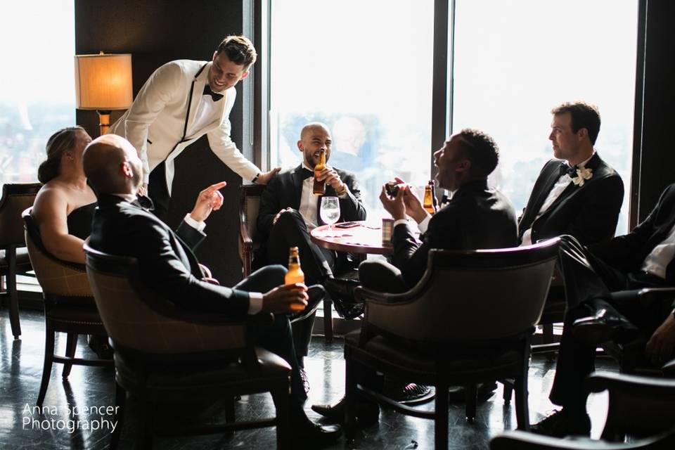 Groom sharing drinks with his guests