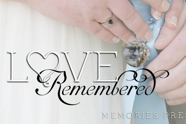 Love Remembered by Build Love - Offering uniquely personal jewelry & accessories, filled with mementos that tell the story of your life & your love.In this picture you'll see two of our creations. First, in the center, is a memorial pendant we created to honor the memory of the bride's best friend. At her wedding the pendant hung from her bouquet. After the wedding, we converted it into a proper pendant with a bail to hang from a chain, so she can wear it whenever she likes.Next, you can see on the groom's sleeve a pair of sterling silver cuff links. We created them using preserved petals from the exact roses he gave to his love on the night he proposed. They also feature two buds of heather flowers that were significant to the couple.We would love to be able to create similarly personal jewelry for you. Whether you're getting married, celebrating an anniversary, or just looking for a special gift for a loved one, let's create one of a kind works of art that celebrate your love!