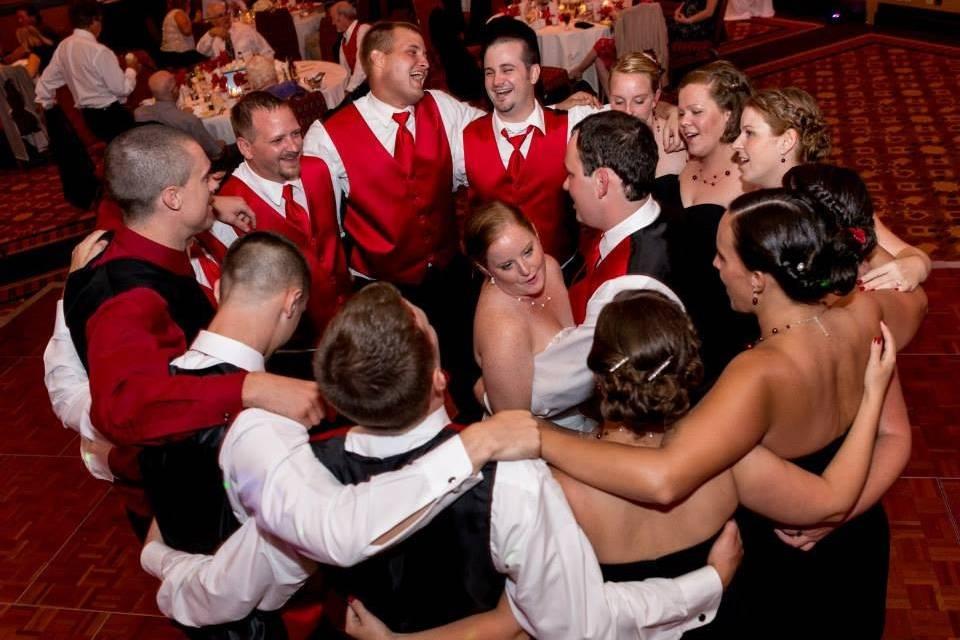 Bridesmaids and groomsmen around the newlyweds