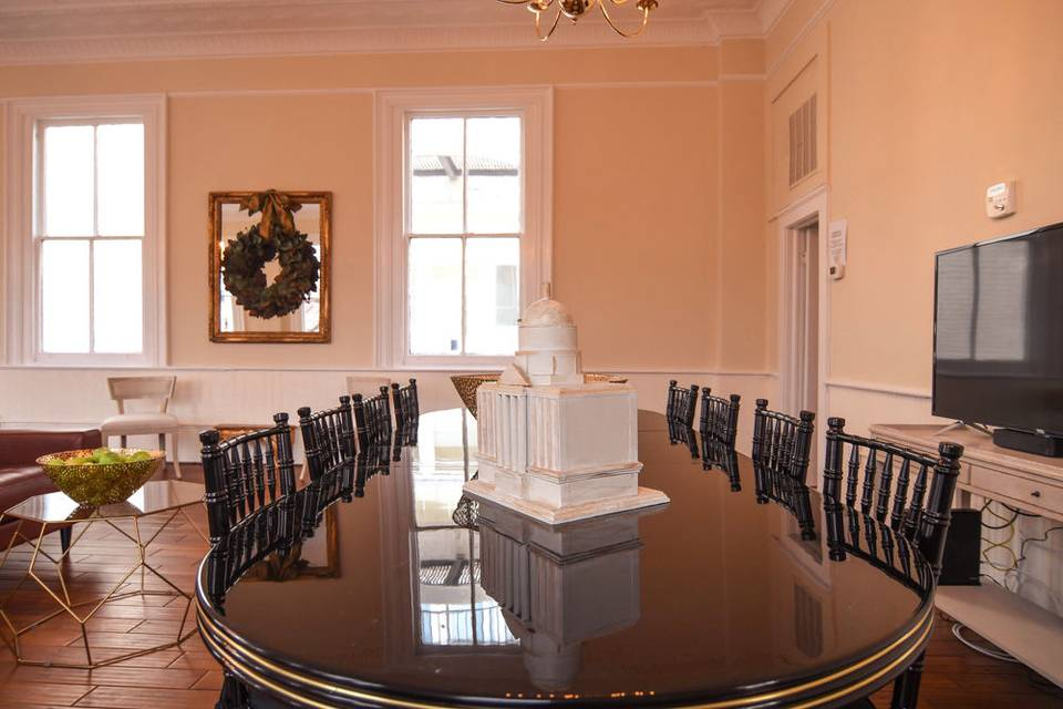 The Miles Redd table that is in the space is available for your use - and for smaller events it seats 12.