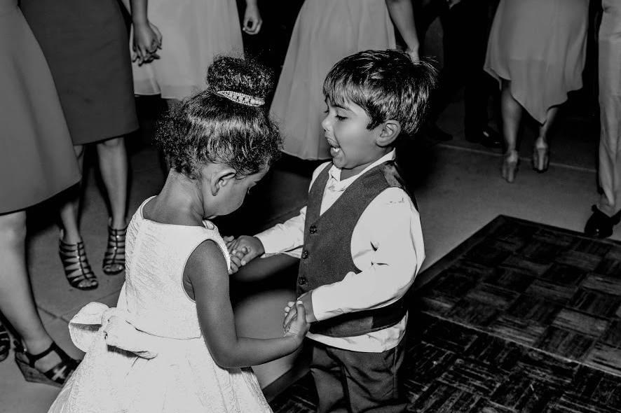 Dancing wedding attendants