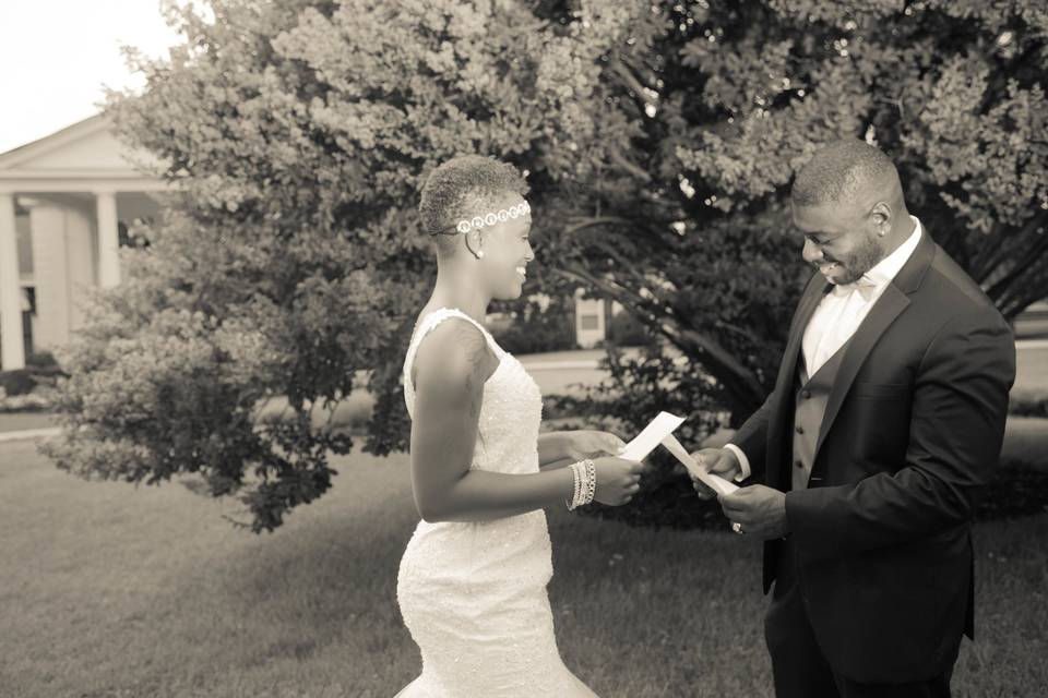 Newlyweds reading their vows
