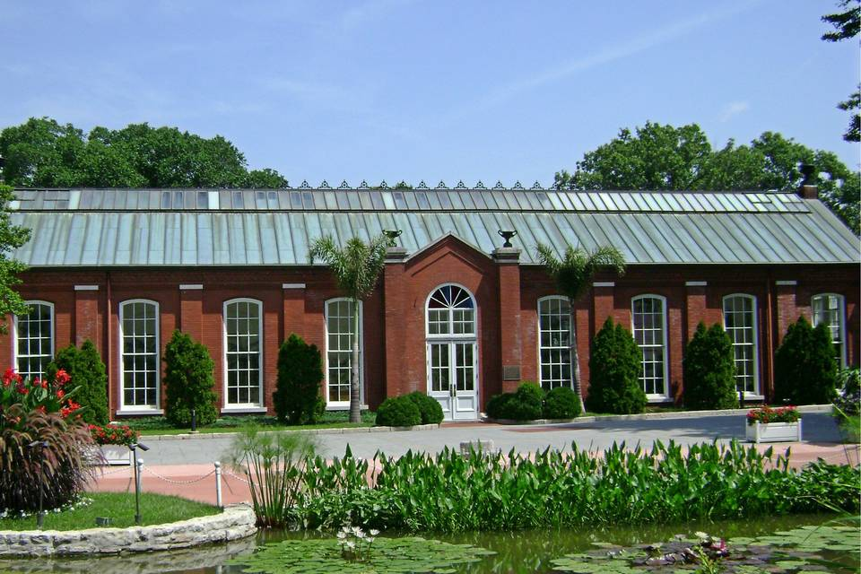 A view of The Piper Palm House from the lily ponds. The rental of The Piper Palm House includes usage of the outdoor plaza along with the indoor conservatory.