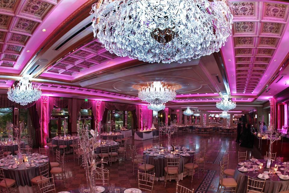 Opulent chandeliers and pink uplighting